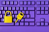 Cyber Data And Information Security Idea. Yellow Padlock And Key On Purple Keyboard. Computer, Infor poster