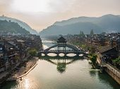 Scenery View In The Morning Of Fenghuang Old Town .phoenix Ancient Town Or Fenghuang County Is A Cou poster