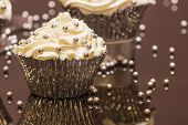 A White Cupcake with Silver Decorative Sprinkles