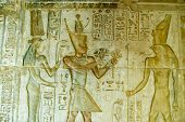 picture of horus  - Ancient Egyptian bas relief carving showing the Pharaoh Ptolemy IV giving papyrus flowers to the god Horus.  Temple of Deir el Medina, Luxor, Egypt.