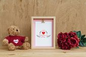 Mockup Picture Frame And Cute Bear With Bouquet Of Red Roses On Rusty Wood. Valentines Day Backgroun poster