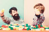 Every Dad And Son Must Do Together. Dad And Kid Build Plastic Blocks. Child Care Development. Family poster