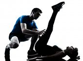 caucasian aerobics instructor  with mature woman exercising fitness workout in silhouette studio iso