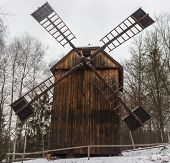 Snowy Landscape In Winter With Retro Windmill In Foreground poster