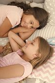 Sharing Secrets. Kids Relaxing On Bed. Sisters Preparing Sleep. Nice Evening. Best Friends. Children poster