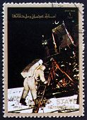 Postage stamp Ajman 1973 Aldrin Stepping out of the Eagle