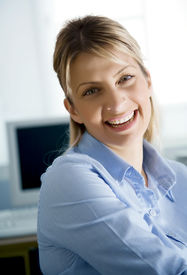 image of blue-collar-worker  - young business woman or IT student smiling - JPG