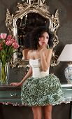 Coquette. Curly Hair Woman In Elegant Dress Over Vintage Mirror