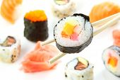 sushi roll over sticks on a sushi background