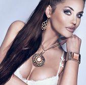 Portrait Of Beautiful Brunette Woman Wearing Gorgeous Jewellery.