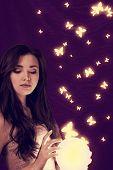 lighting sphere in hands. attractive fairy girl