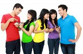 picture of handphone  - Group of Teenage Friends hold their handphone - JPG