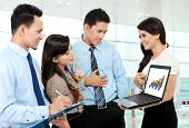 Group Of Business People Meeting With Laptop