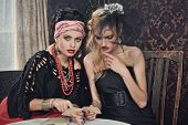 stock photo of gypsy  - Sexy Gypsy Fortune Teller Cards Spells - JPG