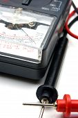 pic of ohm  - A close up view of an ohm meter with black and white probes - JPG