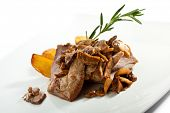 Pork Escalopes with Mushrooms and Potato Slice