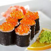 Ikura Maki Sushi - Roll with Fresh Salmon inside. Topped with Ikura (Salmon Roe)