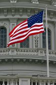 U.s. Flag Flying At The Capitol Building