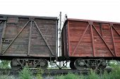 image of amortization  - Two wooden railway carriage on the rails - JPG