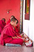 Tibetian Lama Is Praying  At Ramtek Monastery In Gungtok