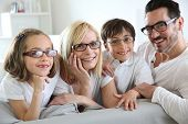 stock photo of daddy  - Family of four wearing eyeglasses - JPG