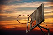 Old Basketball Hoop And A Back Board In Sunset