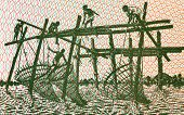 Men Fishing With Stick Nets