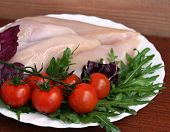 Raw Chicken Breasts With Ruccola And Tomatoes