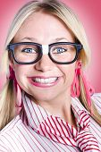 pic of dorky  - Closeup portrait of a happy female office worker wearing dorky glasses with shoelace hair ties - JPG