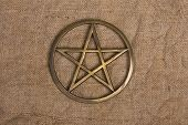 image of pentacle  - close up of brass pentagram  - JPG