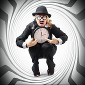 image of pressure point  - Vintage business man holding clock while stuck in a tight time pressured schedule - JPG