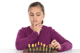 picture of children playing  - Attractive little girl playing chess on a over white background - JPG