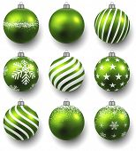 Green christmas balls on white surface. Set of isolated realistic decorations. Vector illustration.