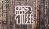 Wooden Buy Two Get One Free Symbol With Presents