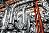 stock photo of cylinder  - Large industrial pipes in a thermal power plant - JPG