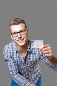 Young Man Showing Off His Driver License