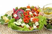 fresh salad with exotic fruits-pitaya- and vegetables isolated on white