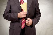 stock photo of cunning  - business man hands him an envelope for corruption - JPG