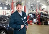 Auto mechanic with wrench. Car repair service.