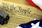picture of bill-of-rights  - US Constitution with Hand Gun  - JPG