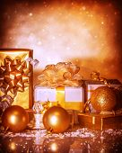Closeup on festive golden Christmastime still life, many different gift boxes, happy holiday, Christmas ornament, winter time season