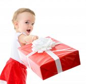 Holidays, baby girl make a present, christmas, birthday, new year, x-mas concept - happy child girl