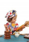 Little Girl Cooking Dressed As A Chef poster
