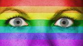 stock photo of gay flag  - Close up of eyes - JPG