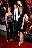 NEW YORK-NOV 20; (l-r) Elizabeth Banks, Liam Hemsworth and Jennifer Lawrence attend