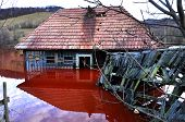 Ecological disaster. A house flooded by contaminated water from a copper open pit mine