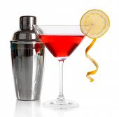 Red cocktail in martini glass with shaker isolated on white