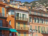 France, Cote d'Azur, Villefranche. Architectural details of houses on the waterfront, view from the