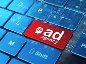 Advertising concept: Head With Gears and Ad Agency on keyboard