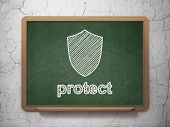 Safety concept: Shield and Protect on chalkboard background